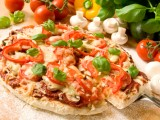 There are a number of pizzas that can be eaten on the Dukan and Paleo Diets, from a Margherita pizza to a thin crust pizza topped with numerous vegetables.